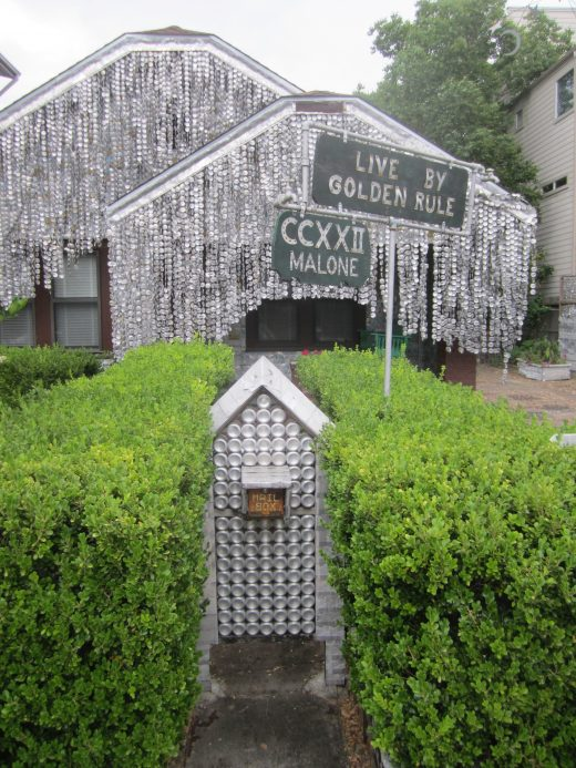 A house covered entirely in squashed beer cans