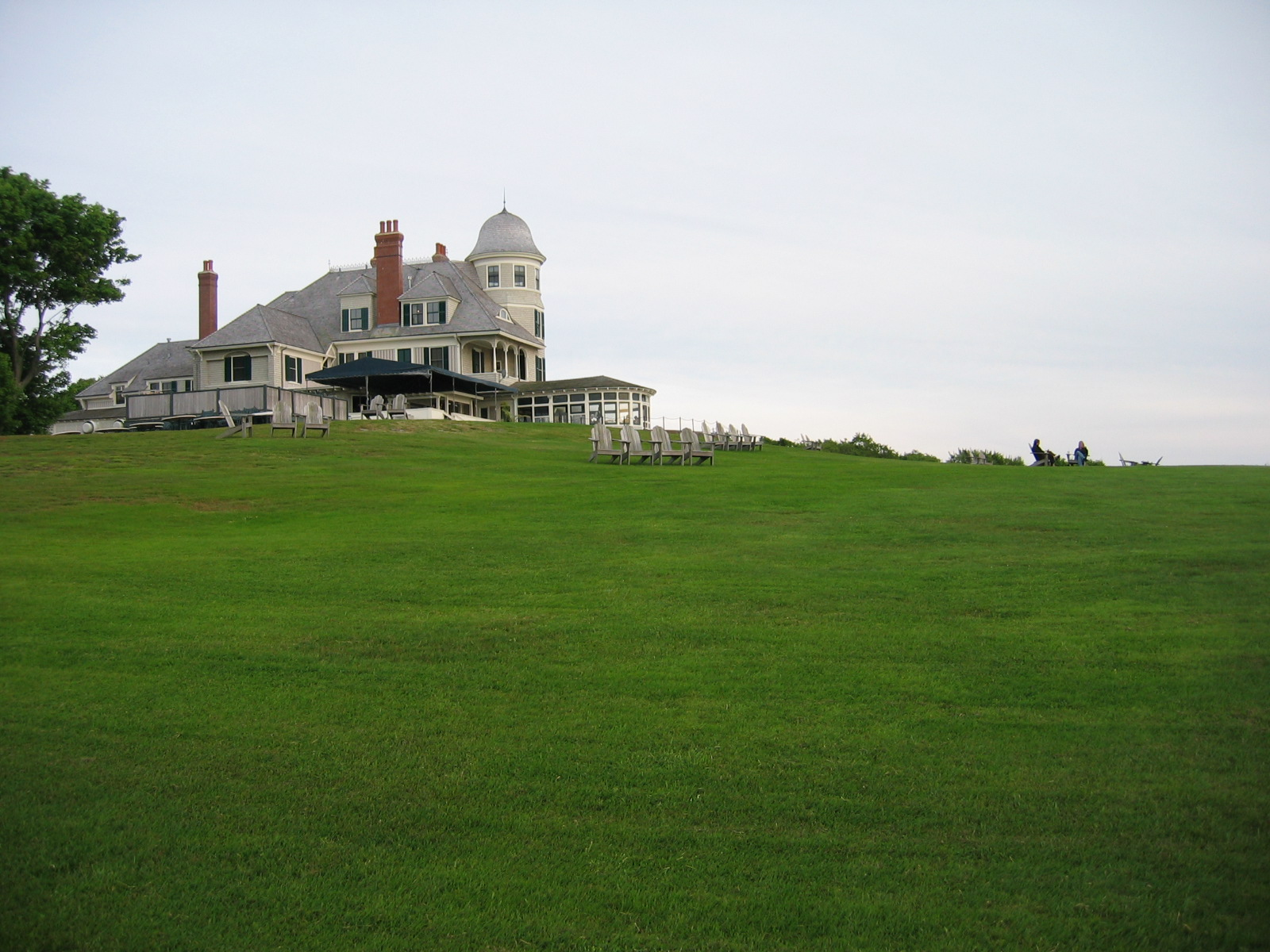 A big old house and a very big, very green lawn.