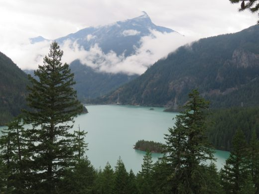Diablo Lake, a turquoise lake with snowy peaks in the background